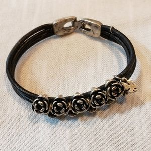 Bracelet with silver roses and black straps